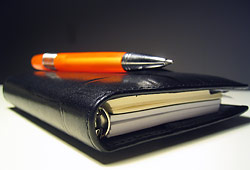 a photograph of a business diary and a pen